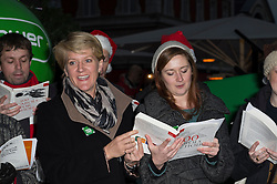 © Licensed to London News Pictures. 10/12/2013. London, UK. Clare Balding launches the Macmillan Tree of Light in aid of Macmillan Cancer Support. The 10m Christmas tree in Covent Garden was lit by Clare who also hung the first bauble. Each bauble is dedicated to a victim of cancer. Clare  dedicated hers to fellow Radio 4 announcer, Rory Morrison who died of cancer 6 months ago. Photo credit : Simon Ford/LNP