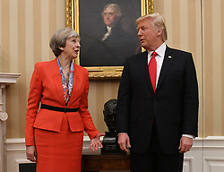 File photo dated 27/01/17 of Prime Minister Theresa May meeting US President Donald Trump. Trump is to visit the UK on July 13 and hold bilateral talks with May, Britain's ambassador to the US has said.