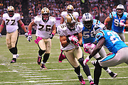 "New Orleans Saints WR Lance Mooore 16 runs towards the endzone then takes a hard hit and fumbles at the goal lineduring the game against the Caoliina Panthers. 3,2010 prior to the Saints game against the Carolina Panthers. The NFL has gone ""Pink"" for October in honor of Breast Cancer Awareness. The Saints went on to win 16-14. John Carney kicked three field goals to help the Saints win. PHOTO©SuziAltman.com"