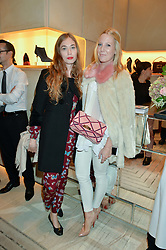 Left to right, ANOUSKA BECKWITH and ALICE NAYLOR-LEYLAND at the Roger Vivier 'The Perfect Pair' Frieze cocktail party celebrating Ambra Medda & 'Miss Viv' at the Roger Vivier Boutique, Sloane Street, London on 15th October 2014.