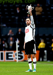 Richard Keogh of Derby County lifts the Brian Clough Trophy after the 3-0 win over Nottingham Forest - Mandatory by-line: Robbie Stephenson/JMP - 11/12/2016 - FOOTBALL - iPro Stadium - Derby, England - Derby County v Nottingham Forest - Sky Bet Championship