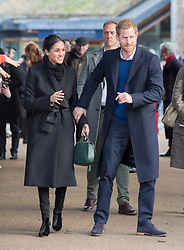 Prince Harry and Meghan Markle meet members of the public during a walkabout as they visit Cardiff Castle.