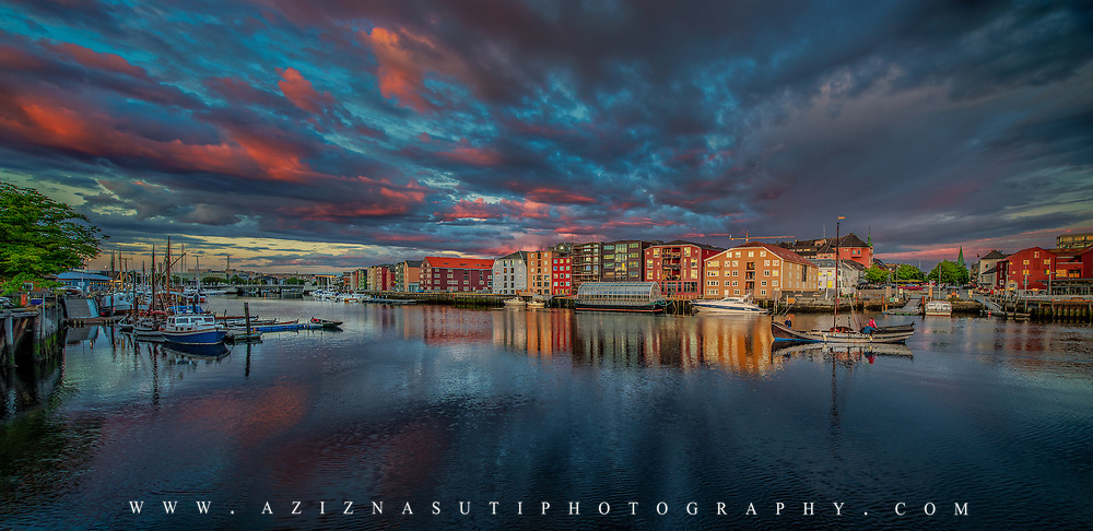 www.aziznasutiphotography.com A beautiful scenary over Nidelva. I was lucky enough to spot the beautiful boat as a compliment to the scene.  You can see the sunset colors on the windows and also both sky and the Nidelva river.