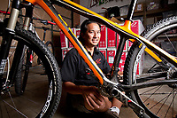 Niner Bikes owner, Chris Sugai, poses with his flagship bike frame, the Air 9 Carbon, at the shop in North Hollywood, CA. October 14, 2010. Photo by David Sprague