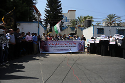 September 10, 2017 - Gaza City, Gaza Strip, Palestinian Territory - Palestiniand hold placards during a protest gainst killing of Muslims in Burma in front of the high commissioner for human rights headquarters, in Gaza city on Sept. 10, 2017  (Credit Image: © Mohammed Asad/APA Images via ZUMA Wire)