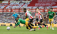 Preston North End's Darnell Fisher (left) goes down in the penalty area under pressure from Brentford's Rico Henry <br /> <br /> Photographer Andrew Kearns/CameraSport<br /> <br /> The EFL Sky Bet Championship - Brentford v Preston North End - Wednesday 15th July 2020 - Griffin Park - Brentford <br /> <br /> World Copyright © 2020 CameraSport. All rights reserved. 43 Linden Ave. Countesthorpe. Leicester. England. LE8 5PG - Tel: +44 (0) 116 277 4147 - admin@camerasport.com - www.camerasport.com
