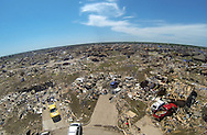 Intact homes (upper right) stand next to totally destroyed dwellings showing the path of the May 20, 2013 tornado in Oklahoma City, Oklahoma May 22, 2013.  Rescue workers with sniffer dogs picked through the ruins on Wednesday to ensure no survivors remained buried after a deadly tornado left thousands homeless and trying to salvage what was left of their belongings. Curvature of horizon in the photo is due to an ultra-wide angle lens.  REUTERS/Rick Wilking (UNITED STATES)