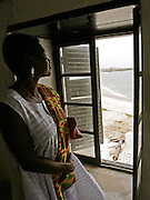 Leader of the House of Lords Baroness Valerie Amos looks at the ocean view through a window as she visits the former slave fort of Elmina Castle in Elmina, Ghana, on Sunday Mar 4, 2007. Amos was visiting on the occasion of the 200th anniversary of the abolition of slave trade, which coincides with Ghana's 50th anniversary of independence...