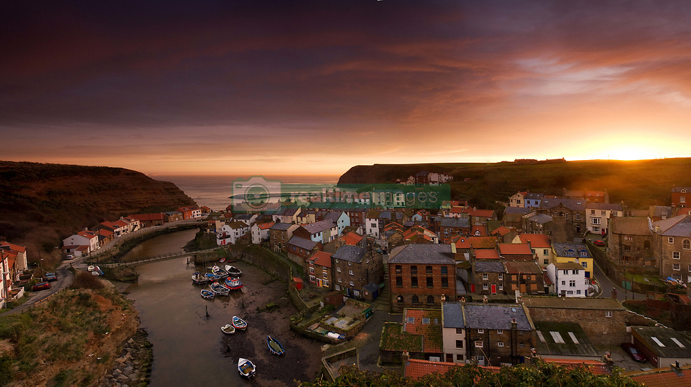 July 21, 2019 - Wide Angle Cityscape At Sunset, Staithes, Yorkshire, England (Credit Image: © John Short/Design Pics via ZUMA Wire)
