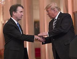 October 8, 2018 - Washington, District of Columbia, U.S. - United States President Donald J. Trump shakes hands with Associate Justice of the US Supreme Court Brett Kavanaugh as he hosts a ceremonial swearing-in ceremony for Kavanaugh in the East Room of the White House in Washington, DC on Monday, October 8, 2018. Kavanaugh formally took the oath on Saturday, hours after he was confirmed by the US Senate. (Credit Image: © Ron Sachs/CNP via ZUMA Wire)