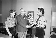 13/07/1967<br /> 07/13/1967<br /> 13 July 1967<br /> Presentation of booklet by Mr H.E.F. Hall, Chairman, National Savings Committee to Dr Conal Hooper, Director of Organisation, Catholic Boy Scouts of Ireland. 5000 copies of the booklet were presented at the National Savings Committee Headquarters in Dublin, to commemorate the C.B.S.I. 40th Anniversary National Camp at Lismore castle, Co. Waterford and as a gesture of appreciation of the work of Scouting Organisations in promoting thrift. The booklet consisted of a series of folders dealing with different trees in Ireland (first series covered 6 trees). <br /> Picture shows Mr Hall (centre) presenting the booklet to Dr Hooper with A.P.L. Sean Flanagan, 7th Dublin (St. Mary's) Troop on left.