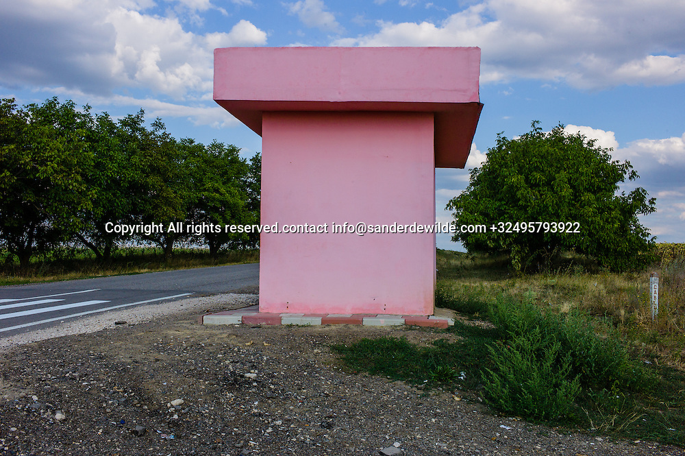 201508 21 Moldova This pink T formed building is a modern bus stop at the mainroad between Chisinau and Rizina