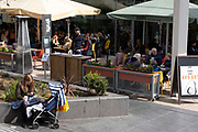 People eating as restaurants along the South Bank reopen, serving customers outside as the national coronavirus lockdown three eases on 13th April 2021 in London, United Kingdom. Now that the roadmap for coming out of the national lockdown has been laid out, this is the first phase of the easing of restrictions.