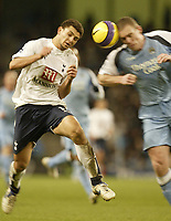 Photo: Aidan Ellis.<br /> Manchester City v Tottenham Hotspur. The Barclays Premiership. 17/12/2006.<br /> City's Richard Dunne nips in to win the ball from Spurs Hossam Ghaly