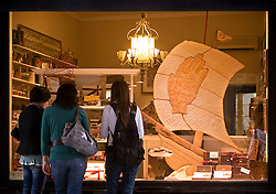 """Window shoppers gaze at the the tasty treats at Philip's Bicuit's in Antwerp, Belgium, Saturday, Sept. 13, 2008. Phiip's is famous for their """"hand biscuits"""" which is part of Antwerp folklore. (Photo © Jock Fistick)"""