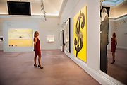 Sotheby's £250m Impressionist & Modern Art and Contemporary Art Summer Sales.  Highlights include: Monet's Water Lilies est £20-30m; a Mondrian, est £13-18m; a Peter Doig, est £9m; a Frances Bacon triptych of his lover George Dyer, est £15-20m; and works by Matisse, Picasso, Basquiat, Warhol (here his Dollar Sign, est£3m - pictured) and Richter. Sotheby's, New Bond Street, London.