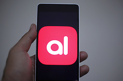 April 27, 2019 - Jakarta, Indonesia - A man seen holding a smartphone with the Akulaku app finance in Jakarta, Indonesia, on April 27, 2019. (Credit Image: © Adriana Adie/NurPhoto via ZUMA Press)