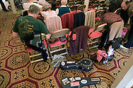 Fans attending the George Formby Appreciation Society's annual gathering in Blackpool, practicing on waiting with their ukuleles prior to playing to the audience at the town's Winter Gardens. The society was formed in 1961 and holds an annual event to celebrate the life of the famous Lancastrian singer and entertainer.