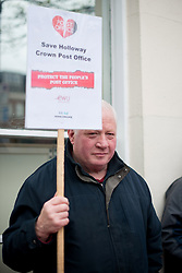© Licensed to London News Pictures. 19/04/2013. London, UK. A striker holds a sign during CWU union strike over jobs and closures at Crown Post Office in Holloway, London on April 19, 2013. Photo credit : Peter Kollanyi/LNP