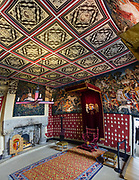 """""""Hunt of the Unicorn"""" replica tapestries in the Scottish Queen's Inner Hall in the Royal Palace at Stirling Castle, in Scotland, United Kingdom, Europe. The Royal Palace was childhood home of Mary Queen of Scots. The palace's lavish design drew on European Renaissance fashions to show off James V's power and good taste. Historic Scotland has recreated the palace interiors as they may have looked when the Scottish king's grand scheme was complete. The """"Hunt of the Unicorn"""" tapestries in the Queen's Lodgings are replicas hand-loomed from 2001-2014, inspired from the seven original tapestries made in Brussels between 1495-1505 (now in the Cloisters museum of New York's Metropolitan Museum of Art). Why a unicorn? In Celtic mythology the unicorn symbolized purity, innocence, masculinity and power. The proud, haughty unicorn was chosen as Scotland's national animal because it would rather die than be captured, just as Scots would fight to remain sovereign and unconquered. Once the capital of Scotland, Stirling is visually dominated by Stirling Castle. Most of Stirling Castle's main buildings date from the 1400s and 1500s, when it peaked in importance. This image was stitched from several overlapping photos."""