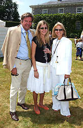 """CAROLINE RUPERT and her parents MR & MRS JOHANN RUPERT he is Chief Executive of Richemont at a luncheon hosted by Cartier at the 2005 Goodwood Festival of Speed on 26th June 2005.  Cartier sponsored the """"Style Et Luxe' for vintage cars on the final day of this annual event at Goodwood House, West Sussex. <br /><br />NON EXCLUSIVE - WORLD RIGHTS"""