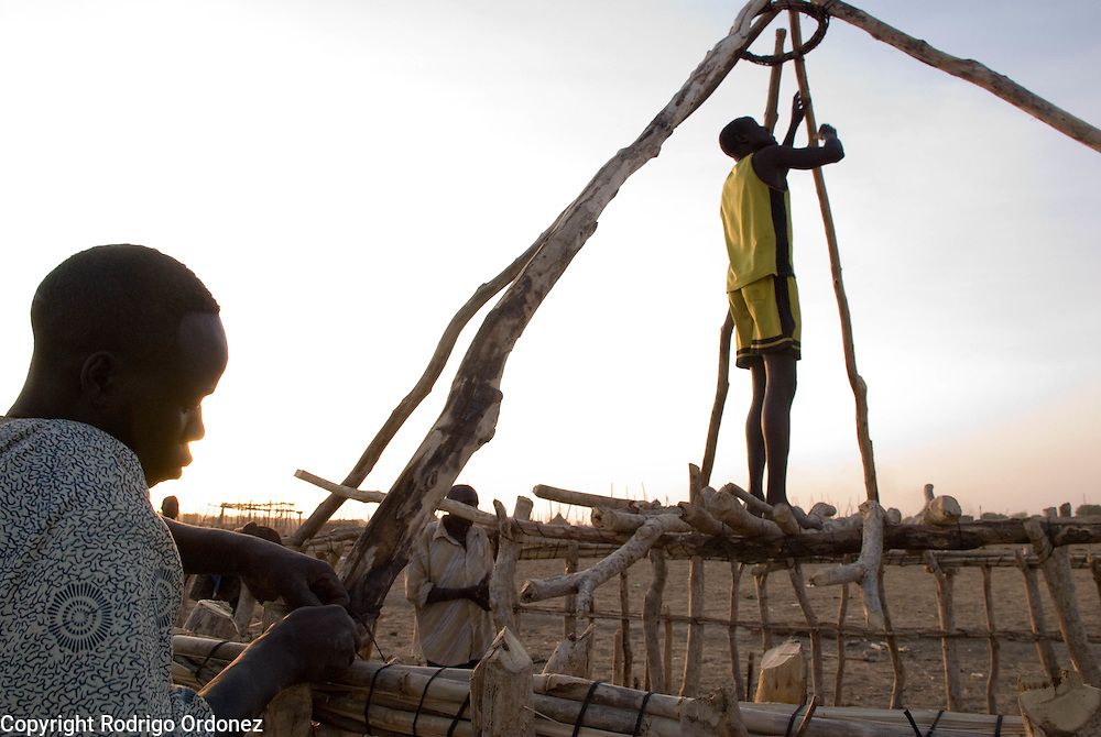 A returnee builds his new home in the outskirts of the town of Abyei.