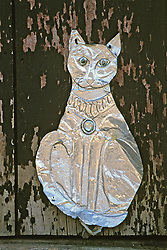 Tin Cat Ornament On Door