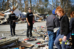 24 February 2016. Sugar Hill RV Park, Convent, Louisiana.<br /> Scenes of devastation following a deadly EF2 tornado touchdown. 2 confirmed dead. <br /> Representatives from battery maker Duracell advise families struggling to recover all they can from their destroyed trailers that there are free batteries available for anyone who needs them.<br /> Photo©; Charlie Varley/varleypix.com