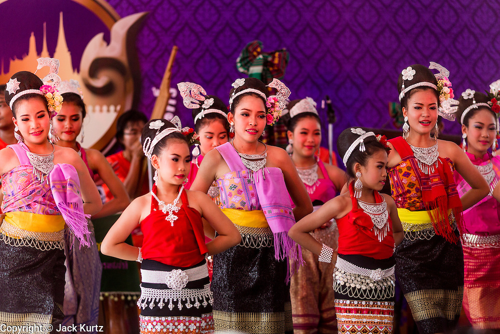 19 APRIl 2014 - BANGKOK, THAILAND: Girls perform Isaan music at the Rattanakosin Festival in Bangkok. Rattanakosin is the name of the man made island that is the heart of the old city. Bangkok was formally founded as the capital of Siam (now Thailand) on 21 April 1782 by King Rama I, founder of the Chakri Dynasty. Bhumibol Adulyadej, the current King of Thailand, is Rama IX, the ninth King of the Chakri Dynasty. The Thai Ministry of Culture organized the Rattanakosin Festival on Sanam Luang, the royal parade ground in the heart of the old part of Bangkok, to celebrate the city's 232nd anniversary.    PHOTO BY JACK KURTZ