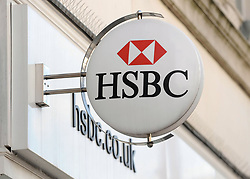 File photo dated 05/02/13 of a sign outside an HSBC branch, as the banking giant reported a rise in half-year profit as the bank hailed a strong performance across its main divisions.