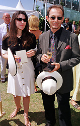 MR SHANE MURRAY and MRS NICK BARHAM she is Gretel Packer daughter of Kerry Packer, at a polo match in West Sussex on 18th July 1999.MUH 49