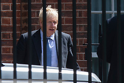 © Licensed to London News Pictures. 21/08/2019. London, UK. Prime Minister Boris Johnson leaves the back of Downing Street. Later today he will travel to Germany and meet Angela Merkel. Photo credit: George Cracknell Wright/LNP