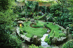 General view of oriental style garden. looking towards the house