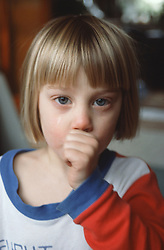 Portrait of young girl sucking thumb,