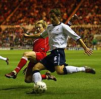 Photo. Andrew Unwin.<br /> Middlesbrough v Tottenham Hotspurs, Barclaycard Premier League, Riverside Stadium, Middlesbrough 09/03/2004.<br /> Middlesbrough's Gaizka Mendieta (l) tries to block a cross from Tottenham's Michael Brown (r).