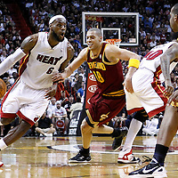 24 January 2012: Miami Heat small forward LeBron James (6) drives past Cleveland Cavaliers shooting guard Anthony Parker (18) on a screen set by Miami Heat power forward Udonis Haslem (40) during the Miami Heat 92-85 victory over the Cleveland Cavaliers at the AmericanAirlines Arena, Miami, Florida, USA.