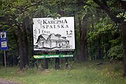 Roadside billboard advertising a Polish Karczma restaurant. Spala Central Poland