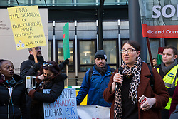 London, UK. 22nd January, 2019. Laura Pidcock, Shadow Minister for Business, Energy and Industrial Strategy (BEIS), addresses BEIS support staff represented by the Public and Commercial Services (PCS) union on the picket line after beginning a strike for the London Living Wage of £10.55 per hour and parity of sick pay and annual leave allowance with civil servants. The strike is being coordinated with receptionists, security staff and cleaners at the Ministry of Justice (MoJ) represented by the United Voices of the World (UVW) trade union.