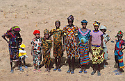 Girls and women outside the mud walled mosque (Muslim) on Friday at mid day prayers in the W. African town of Tigona, Mali. Material World Project.