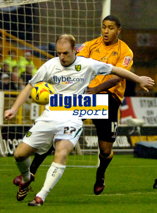 Photo: Ed Godden.<br />Wolverhampton Wanderers v Norwich City. Coca Cola Championship. 23/12/2006. Wolves' Leon Clarke (R), tackles Gary Doherty from behind.