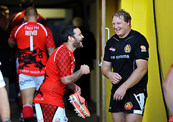 Piri Weepu (London Welsh) and Thomas Waldrom (Exeter Chiefs) share a joke after the match - Photo mandatory by-line: Patrick Khachfe/JMP - Mobile: 07966 386802 06/09/2014 - SPORT - RUGBY UNION - Oxford - Kassam Stadium - London Welsh v Exeter Chiefs - Aviva Premiership