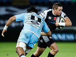 Hanno Dirksen of Ospreys evades the tackle of David Tameilau of Glasgow Warriors<br /> <br /> 2nd November, Liberty Stadium , Swansea, Wales ; Guinness pro 14's Ospreys Rugby v Glasgow Warriors ;  <br /> <br /> Credit: Simon King/News Images<br /> <br /> Photographer Simon King/Replay Images<br /> <br /> Guinness PRO14 Round 8 - Ospreys v Glasgow Warriors - Friday 2nd November 2018 - Liberty Stadium - Swansea<br /> <br /> World Copyright © Replay Images . All rights reserved. info@replayimages.co.uk - http://replayimages.co.uk