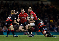 Scarlets' John Barclay is tackled by Dragons' Harrison Keddie<br /> <br /> Photographer Simon King/Replay Images<br /> <br /> Guinness PRO14 Round 21 - Dragons v Scarlets - Saturday 28th April 2018 - Principality Stadium - Cardiff<br /> <br /> World Copyright © Replay Images . All rights reserved. info@replayimages.co.uk - http://replayimages.co.uk
