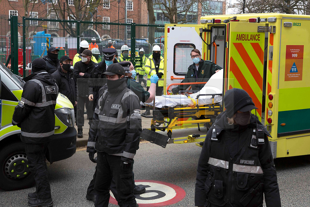 """© Licensed to London News Pictures.22/02/2021. London, UK. An ambulance arrives to An Anti-HS2 campaigner known as """"Larch"""" which will be removed from London's Euston Square Gardens by bailiffs from a 100ft tunnel. Photo credit: Marcin Nowak/LNP"""