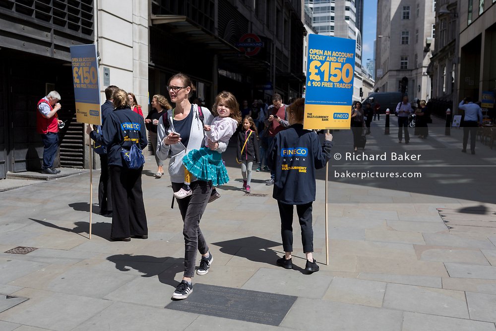 Young people help Fineco Bank advertise the brand in a PR event outside Monument Underground station in the City of London, the capital's financial district, on 17th June 2019, in London, England.