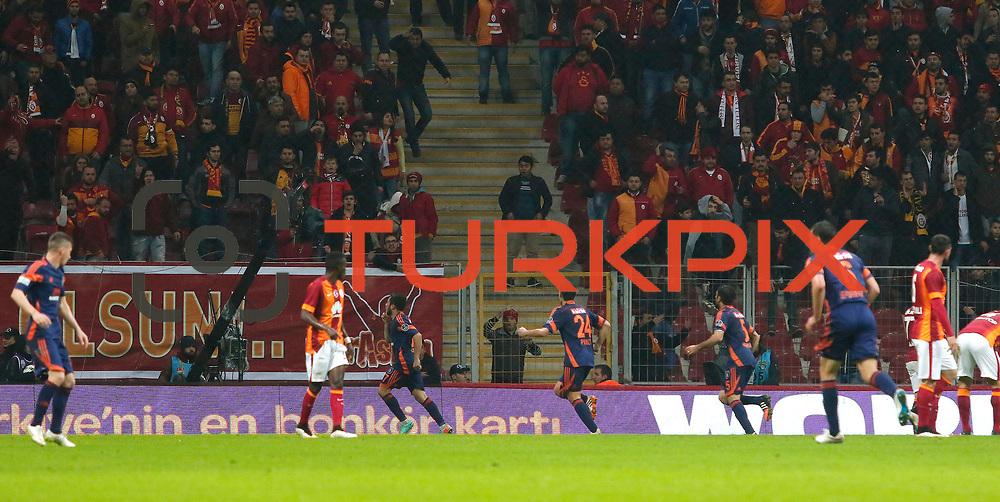 Istanbul Basaksehir's players celebrate goal during their Turkish Super League soccer match Galatasaray between Istanbul Basaksehir at the AliSamiYen Spor Kompleksi TT Arena at Seyrantepe in Istanbul Turkey on Saturday, 14 March 2015. Photo by Aykut AKICI/TURKPIX