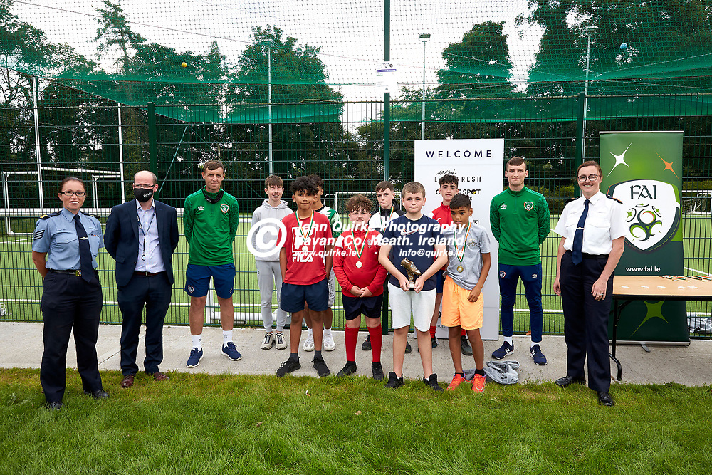 04-08-21, Garda youth diversion Soccer Initiative project in association with Meath Sports Partnership<br /> at Our Lady of Mercy school, Kells.<br /> The winning team pictured with organisers and sponsor.<br /> Sergeant Elaine Long, Damien Duffy (Sponsor: Park Ri) with FAI representatives Richard Smith and Conor Woods and Superintendent Thelma Watters<br /> Photo: David Mullen / www.quirke.ie ©John Quirke Photography, Proudstown Road Navan. Co. Meath. 046-9079044 / 087-2579454.<br /> ISO: 320; Shutter: 1/250; Aperture: 6.3;