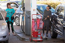 © Licensed to London News Pictures 27/09/2021.<br /> Swanley, UK, Chaos at this Co-op petrol station in Swanley, Kent. This station had a delivery at 7.30 am this morning and at 2.30pm started to run out of diesel. Fuel panic buying continues today on forecourts up and down the UK as hoarders run petrol stations dry. Photo credit:Grant Falvey/LNP