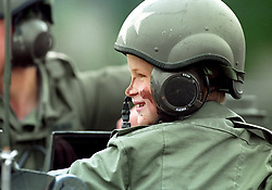 PRINCE HARRY WEARS CAMOUFLAGE PAINT AS HE RIDES IN A LIGHT TANK DURING A VISIT TO THE BARRACKS OF THE LIGHT DRAGOONS IN HANNOVER, GERMANY.