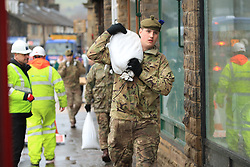 Soldiers from The Highlanders, 4th Battalion, the Royal Regiment of Scotland in Mytholmroyd assisting with flood defences, in the Upper Calder Valley in West Yorkshire, as the UK is braced for widespread weather disruption for the second weekend in a row as Storm Dennis sweeps in.
